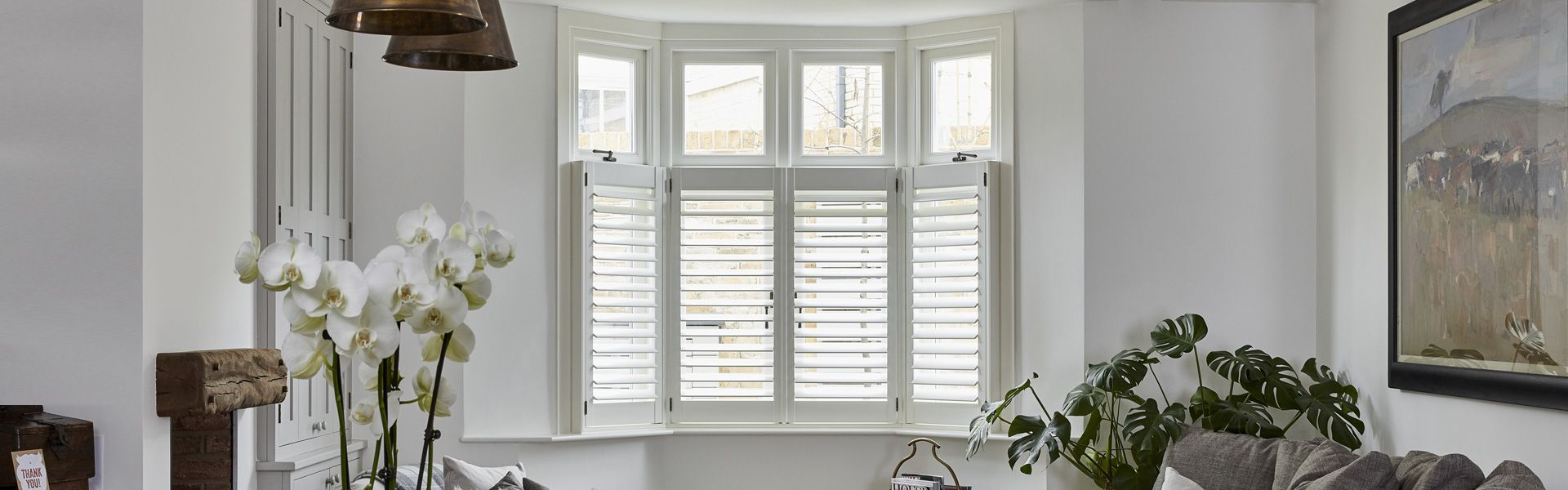 Café Style Shutters for Bay Windows by Plantation Shutters Ltd