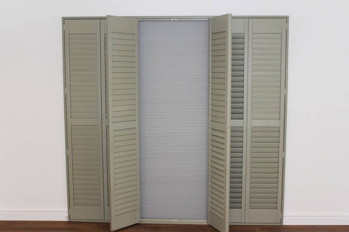 Closed doorway room darkening blinds by Plantation Shutters Ltd