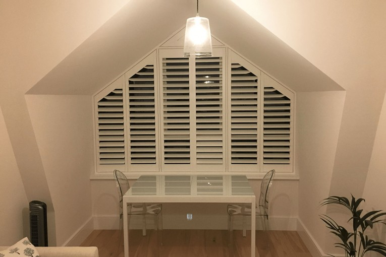 Special Shaped Shutters in the Living Room - Dining Room
