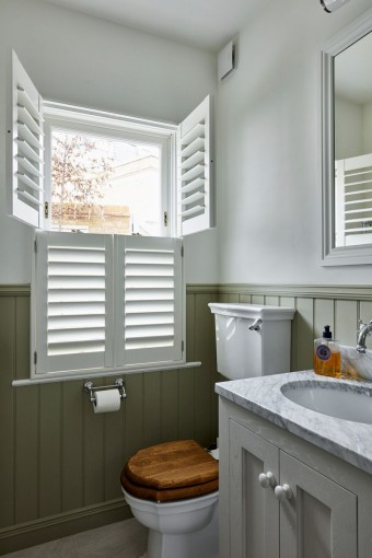 Bathroom Tier on Tier Shutters by Plantation Shutters Ltd