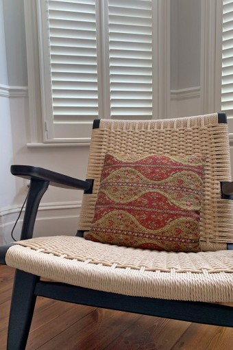 Living Room Chair and Shutters by Plantation Shutters Ltd.jpg
