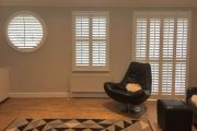 Special Shape and Full Height Shutters in a Living Room