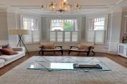 Living Room Cafe Shutters by Plantation Shutters Ltd.jpg