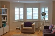 Full Height Shutters on a Bay Window in a Living Room
