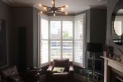 Full Height Shutters in a Bay Window in the Living Room