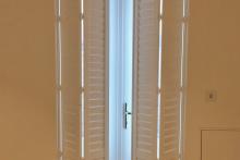Full Height Bi-Folding Shutters for Patio Doors in the Living Room