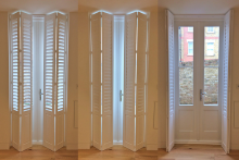 Full Height Bi-folding Solid Panel Shutters for Patio Doors in the Living Room