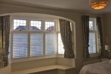 Cafe Style Shutters in a Bedroom