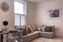 Cafe Style Shutters in a Living Room and Dining Room