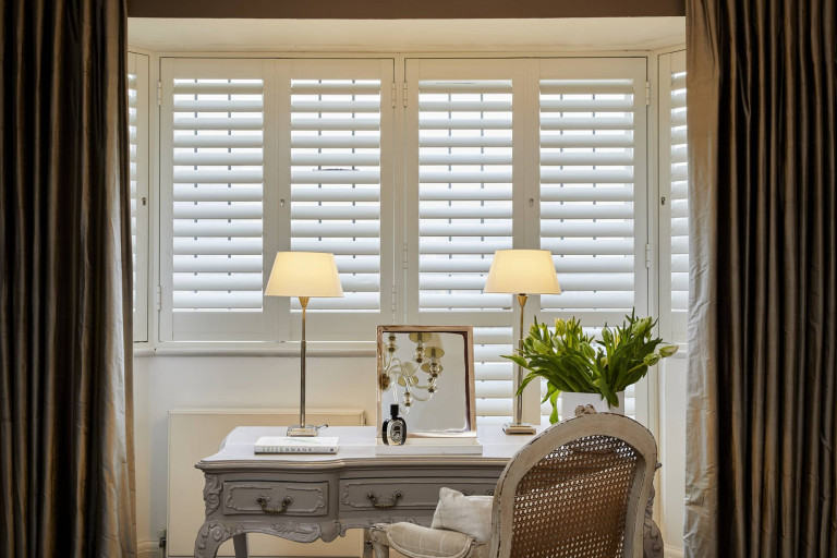 Aluminium Security Shutters with Desk by Plantation Shutters Ltd.jpg