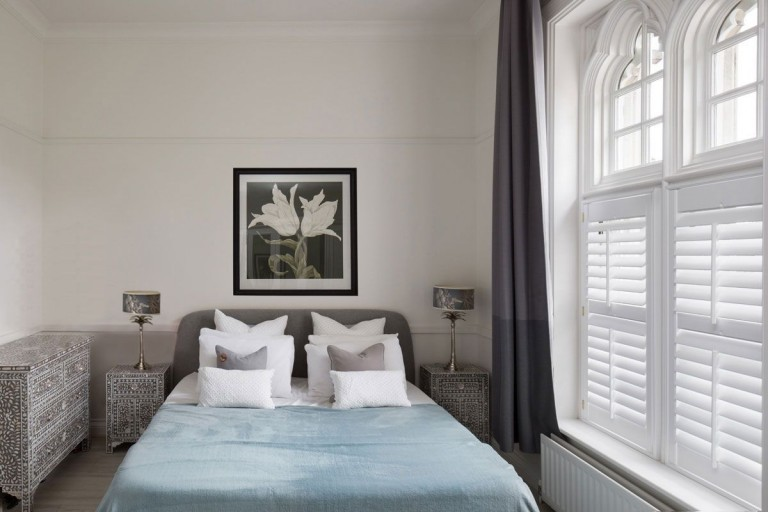 Luxurious Bedroom by Plantation Shutters Ltd