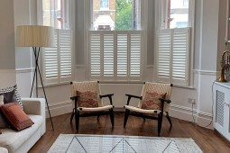 Living Room Cafe Shutters by Plantation Shutters Ltd.jpg