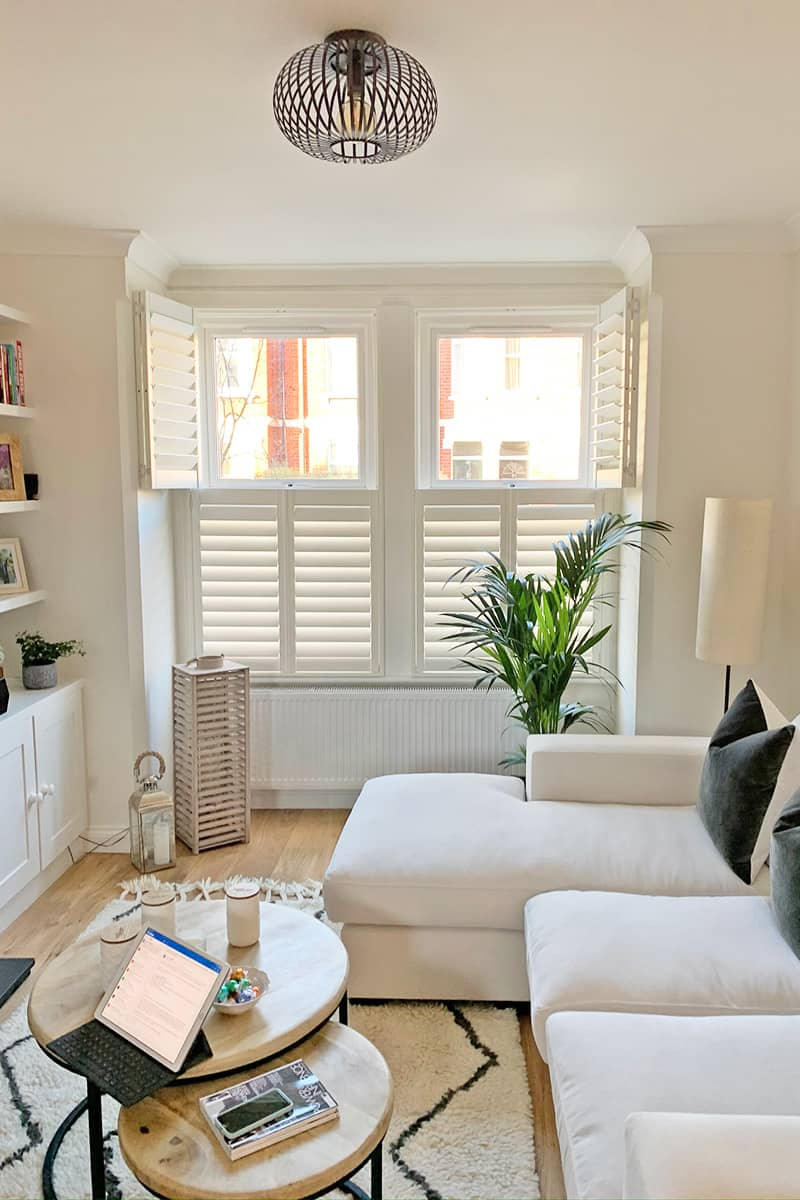 Tier on Tier Shutters for Living Room Windows by Plantation Shutters Ltd